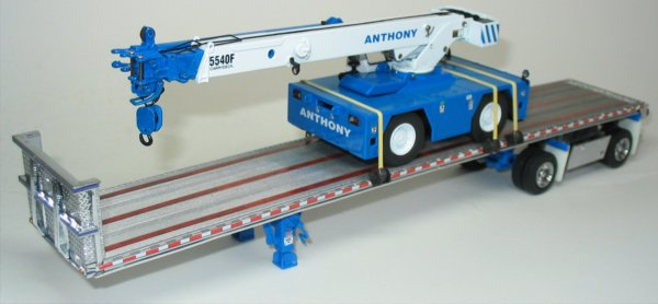 Freightliner Century with East flatbed trailer and Carrydeck crane load